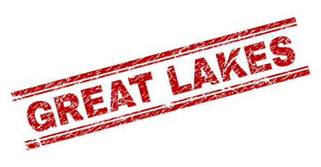 GREAT LAKES seal print with corroded style. Red vector rubber print of GREAT LAKES text with scratched texture. Text title is placed between double parallel lines.