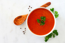 Homemade Tomato Soup. Top View, Simple Table Scene On A Bright Granite Background.