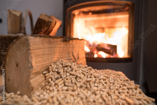 Papiers peints Pays d Afrique Wood stove heating with in foreground wood pellets - economical heating system concept