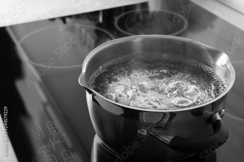 Canvas-taulu Pot with boiling water on electric stove, space for text