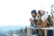 Leinwanddruck Bild - Couple with backpacks enjoying mountain view during winter vacation. Space for text