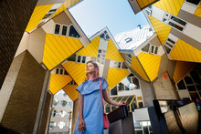 The Girl On The Background Of The Cube House Or Kubuswoningen In Dutch Are A Set Of Innovative Houses Designed By Architect Pete Blom And Built In Rotterdam
