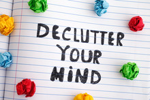Phrase Declutter Your Mind On Notebook Sheet With Colorful Crumpled Paper Balls Around It