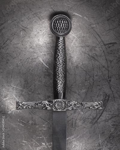 ancient sword on a metal background Fototapet