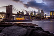 View of the Brooklyn Bridge and Manhattan from the riverside of the East River at sunset - 1