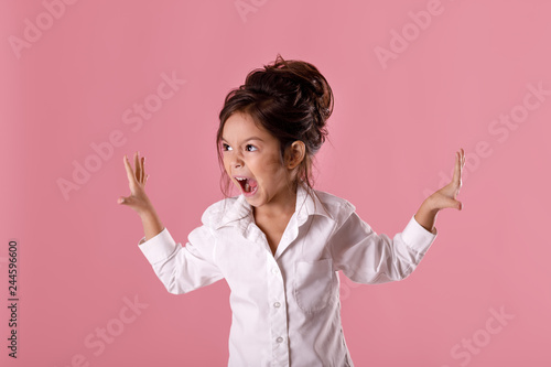 Fotografia, Obraz angry little child girl in white shirt with hairstyle