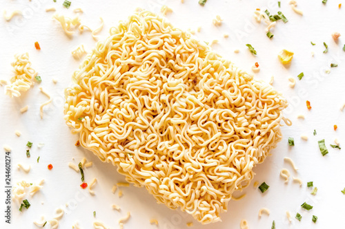 dry instant noodles with seasonings on a white background close-up