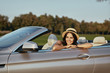 woman sitting in luxury cabrio