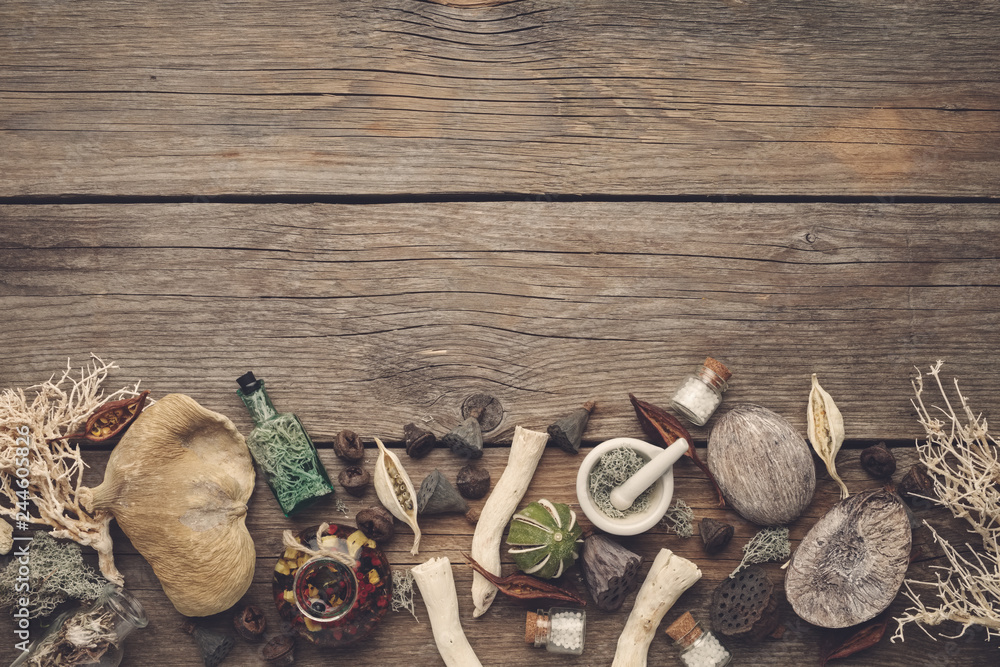 Fototapety, obrazy: Dried moss, dry roots, nut shell, coconuts, plants, eucalyptus, lotus seeds, bottles of infusion and homeopathic globules, mortar and pestle. Top view. Copy space for text.