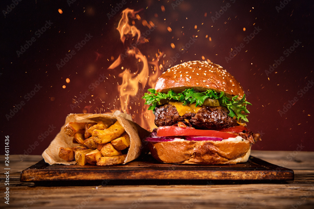 Fototapety, obrazy: Tasty burger with french fries and fire.