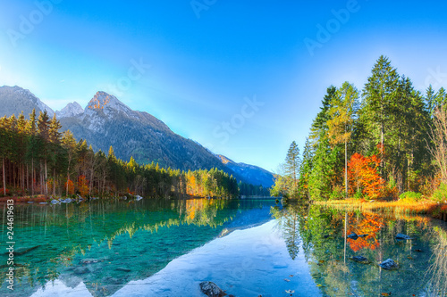Photo Stands Autumn Beautiful autumn sunrise scene with trees near turquoise water of Hintersee lake