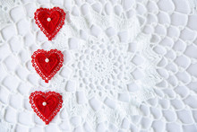 Red Lace Hearts Placed On Side Of White Lace Background