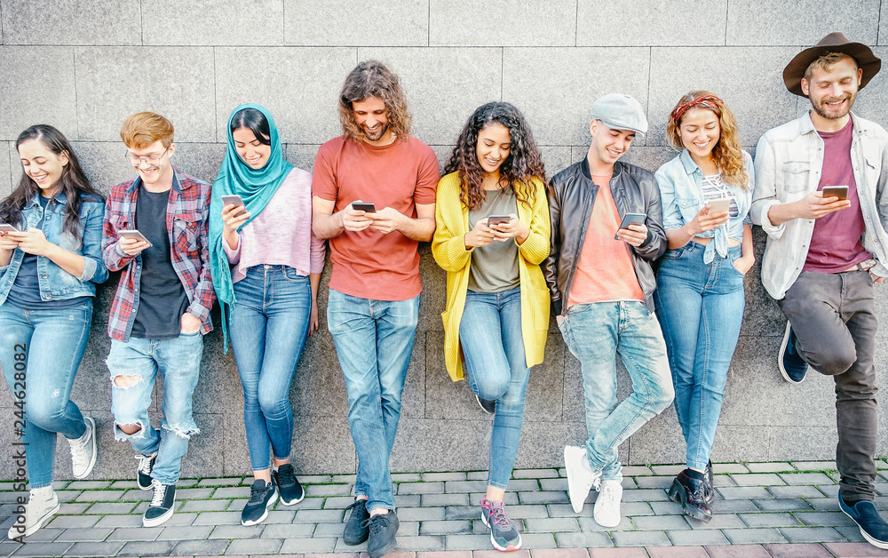 Fototapeta Group of fashion friends watching on their smart mobile phones - Millennial generation z addicted to new technology trends - Concept of people, tech, social media, friendship and youth lifestyle