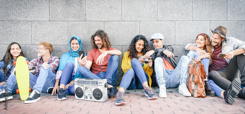 Group of multiracial friends having fun outdoor - Millennial young people using mobile phones taking photo and listening music with vintage stereo - Generation z, social and youth lifestyle concept - 244628090