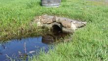 Small Culvert With Stream Running Through