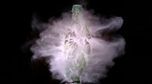 Glass Bottle Shattering In Space Giving Off Purple Smoke And Haze