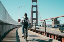 Bicyclist Riding Bike On Golden Gate Bridge