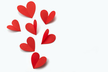 Red Paper Hearts On White Background Concept Of Valentine's Day