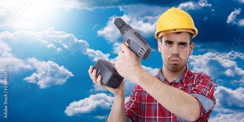 constructor with drill, renovations, repairs and bricolage Canvas Print