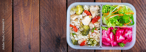 Lunch box chicken, broccoli, green peas, tomato with rice and red cabbage. Healthy fitness food. Take away. Lunchbox. Banner. Top view