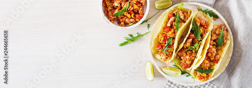 Mexican tacos with chicken meat, corn and tomato sauce. Latin American cuisine. Taco, tortilla, wrap. Banner.  Top view. Flat lay