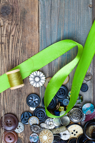 Garden Poster Oceania set of vintage buttons with green tape and spool of thread