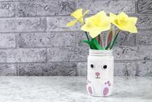 DIY Easter Vase Bunny From Glass Jar, Felt, Googly Eyes On A Green Background