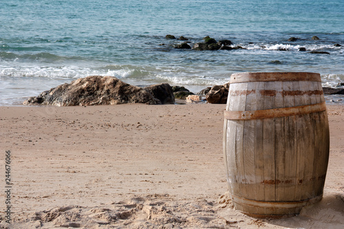 a wine barrel washed ashore by the waves