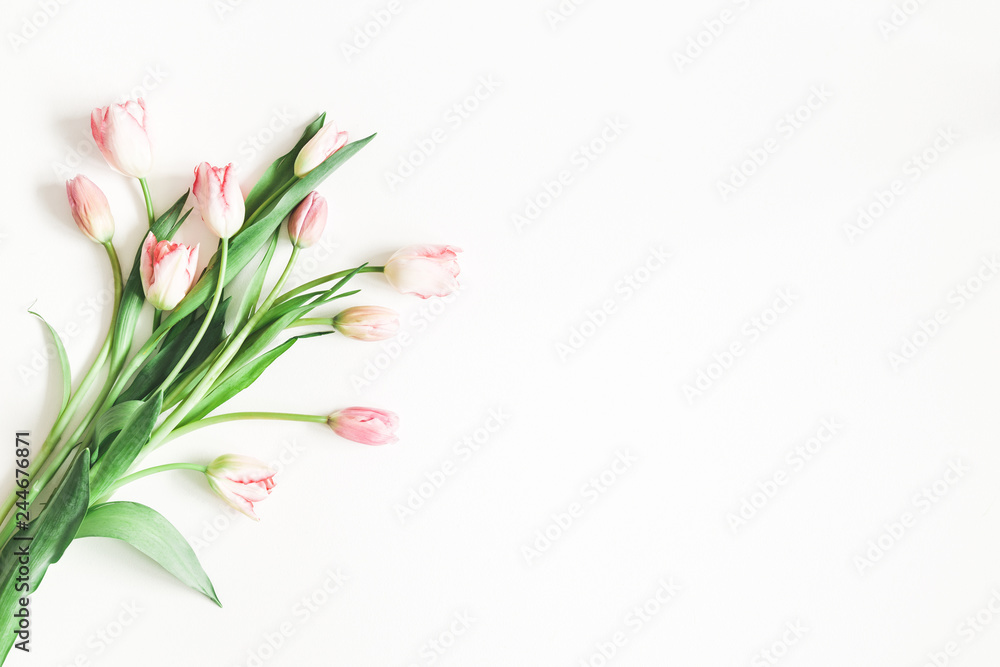 Flowers composition. Pink tulip flowers on white background. Valentines day, mothers day, womens day concept. Flat lay, top view, copy space