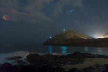 Super Blood Wolf Moon Eclipsed Over Makapu'u Beach Park With Misty Water Washing In Over Rocks In Honolulu, Hawaii