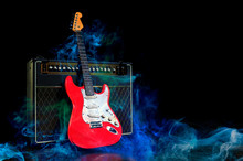 Red Electric Guitar And Amplif...