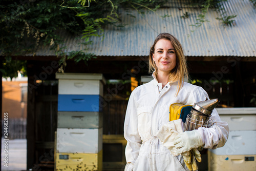 Beekeeper in front of her bee hives Canvas Print