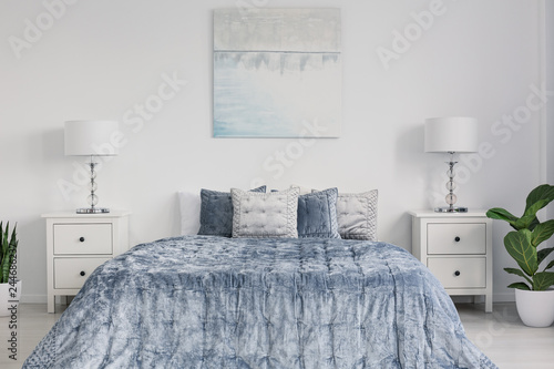Symmetry in design of elegant new york style bedroom with ...