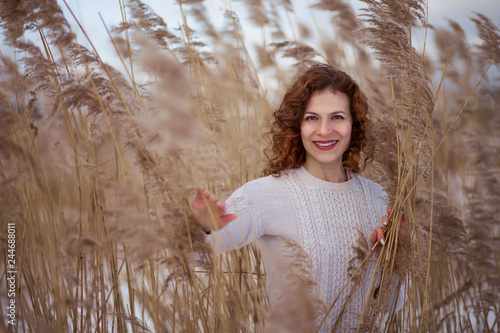 Fotografie, Obraz  portrait of a girl in winter among cane