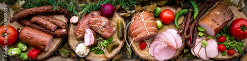 Foto op Canvas Vlees Assortment of cold meats: sausages, ham, bacon