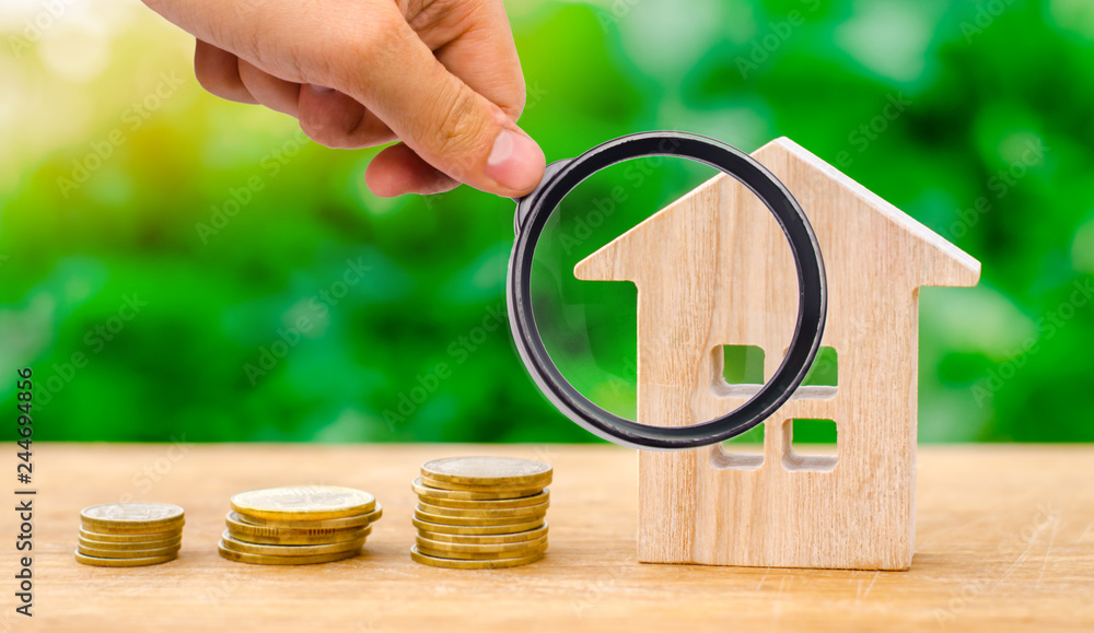 Fototapety, obrazy: Stacks of coins and a wooden house. The concept of saving money for buying a home. Buy an apartment, real estate. Payment of rent for the apartment. Property tax repayment. Focus on the house.