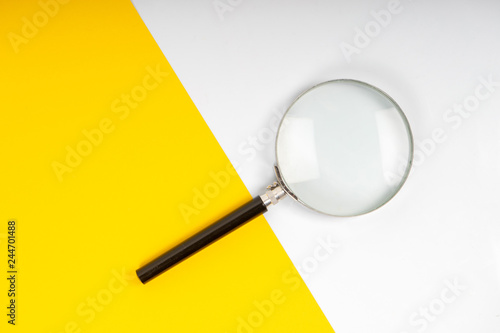 Photo Magnifier glass on the yellow background
