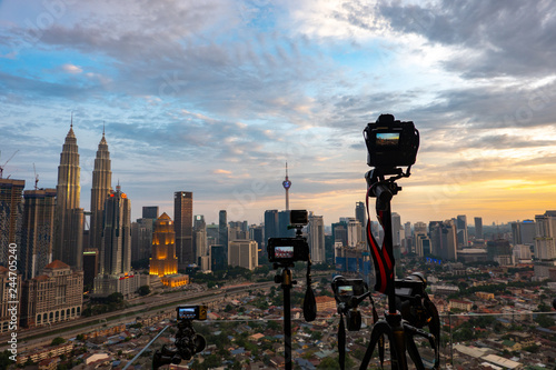 KUALA LUMPUR, MALAYSIA - AUGUST 31, 2018: Camera with cityscape view background Canvas Print