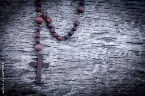 Close up rosary against wooden background as symbol of salvation and eternal life Tapéta, Fotótapéta