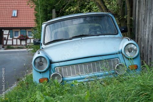 Leinwand Poster Old Eastern Europe GDR car is in the green meadow