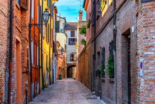 Old narrow street with arch in Ferrara, Italy.  Ferrara is capital of the Province of Ferrara