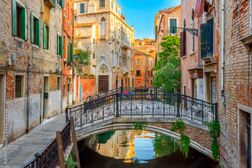 Fototapety, obrazy: Narrow canal with bridge in Venice, Italy. Architecture and landmark of Venice. Cozy cityscape of Venice.