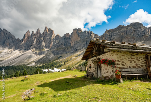 Foto auf Leinwand Gebirge Beautiful mountain landscape of rifugio Brogles in Dolomites Italy. Tranquil hutte on top of mountain