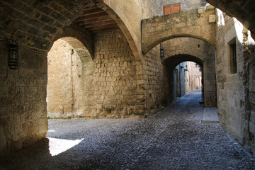 Medieval arched street in the town of Rhodes