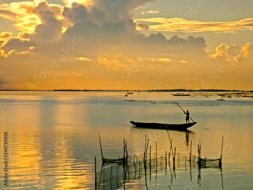 Obraz na plátně Beautiful sunrise of the Chilika Lake in orange color at Odisha state in  India
