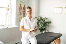 A Modern Rehabilitation Physiotherapy Woman Worker At Job