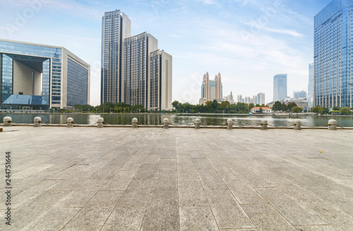 empty tiled floor and urban skyline,tianjin china