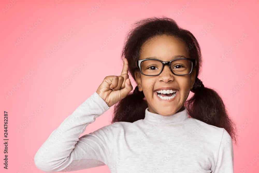 Fototapeta African-american girl in eyeglasses having idea over background