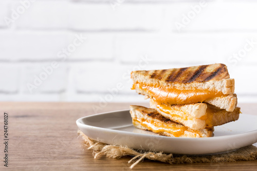 Grilled cheese sandwich on wooden table. Copyspace