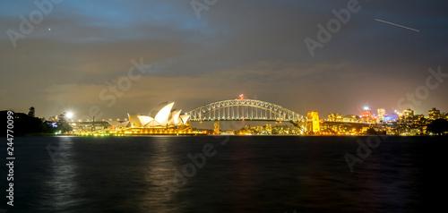 Staande foto Sydney SYDNEY, AUSTRALIA - SEPTEMBER 08, 2016: Night view of Sydney Harbour. More tha 15 million people visit Sydney annually.